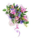 Bouquet of nerine, hyacinth, statice and other flowers. Delicate beautiful bouquet of nerine, hyacinth, statice and other flowers in pink packaging with tape Stock Photos