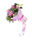 Bouquet of nerine, hyacinth, statice and other flowers. Delicate beautiful bouquet of nerine, hyacinth, statice and other flowers in pink packaging with tape Royalty Free Stock Photo