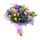 Bouquet of nerine, iris, alstroemeria, roses and other flowers. Delicate beautiful bouquet of nerine, iris, alstroemeria, roses and other flowers in pink Stock Photo