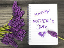 bouquet and notepad with words `happy mother`s day` royalty free stock images