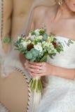 Bouquet nuptiale dans des mains Photo libre de droits