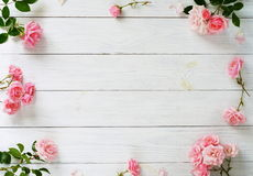 Free Bouquet Of Beautiful Pink Roses And Gift In Pink Packing On White Wooden Background.Top View.Copy Space Royalty Free Stock Photos - 97392078