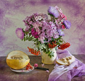 Bouquet Of Flowers And Melon Royalty Free Stock Photo