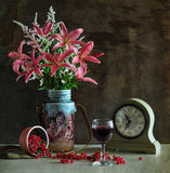 Bouquet Of Lilies And Glass Of Wine Royalty Free Stock Photos