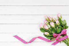 Bouquet Of Pink Roses Decorated With Ribbon On White Wooden Background. Top View Stock Photos