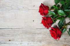 Bouquet Of Red Roses On Wooden Background Royalty Free Stock Image