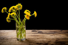 Bouquet Of Yellow Dandelions In Glass Stock Photos