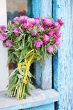 Bouquet on old window. Beautiful bouquet of wild flowers clover royalty free stock photos