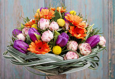 Bouquet of orange gerbera daisies, violet tulips and pink roses Royalty Free Stock Image