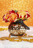 Bouquet of orange and red roses in golden vase Stock Images