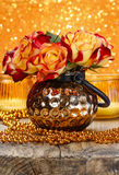Bouquet of orange and red roses in golden vase Stock Photo