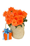 Bouquet of  orange roses in basket Royalty Free Stock Images