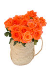 Bouquet of  orange roses in basket Royalty Free Stock Image