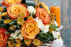 Bouquet of orange roses and ivory carnation flowers Stock Images