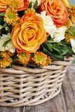 Bouquet of orange roses and ivory carnation flowers Royalty Free Stock Images