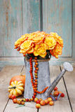 Bouquet of orange roses in silver watering can Royalty Free Stock Image