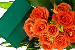 Bouquet of orange roses and ticket Stock Images