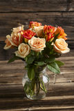 Bouquet of orange roses Stock Photos