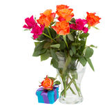 Bouquet of  orange roses  in vase and  gift box Stock Photos
