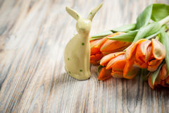 Bouquet of orange tulips and Easter bunny Stock Photo
