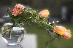Bouquet with orange tulips, pinks Stock Photo