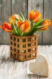 Bouquet of orange tulips and heart royalty free stock photos