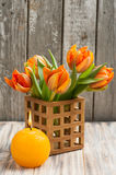 Bouquet of orange tulips, lit candle Stock Photography