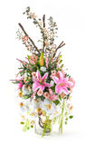 Bouquet of orchid and lily in glass vase. Bouquet of orchid, rose and lily in glass vase  on white Royalty Free Stock Photo