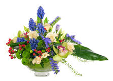 Bouquet from orchids and other flowers in glass vase isolated. Stock Image