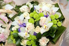 Bouquet with orchids and roses Stock Photos