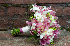 Bouquet from orchids, roses, irises and other flowers on a natural background Stock Photo