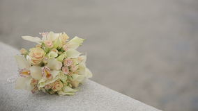 A bouquet orchids and roses on the railing of the balcony sea background stock footage