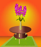 Bouquet of orchids in a vase on the coffee table Stock Photo