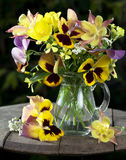 Bouquet of pansies. On an old board Royalty Free Stock Photos