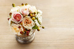 Bouquet of pastel pink and peach roses on wooden background Royalty Free Stock Photo
