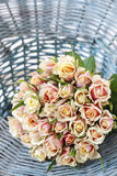 Bouquet of pastel roses in turquoise wicker basket Royalty Free Stock Images