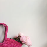 Bouquet of peonies in a bag Royalty Free Stock Photography