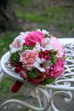 Bouquet with peonies, carnations and alstroemeria. Wedding ceremony - a bouquet of the bride Royalty Free Stock Photography