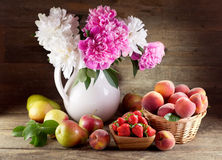 Bouquet of peonies and fruits Stock Photo