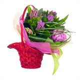 Bouquet of peonies, hyacinths and other flowers in wicker basket Royalty Free Stock Photos
