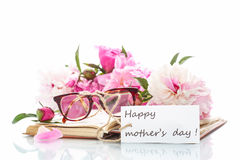 Bouquet of peonies  on old book with glasses Royalty Free Stock Images