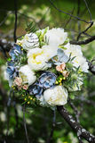 A bouquet of peonies. Bouquet of peonies and other flowers on the branches of a tree weighs stock photo