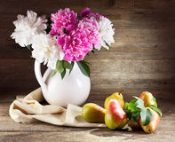 Bouquet of peonies and pears Stock Photo