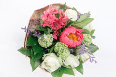 Bouquet of peonies, roses and alstroemeria. On white background Royalty Free Stock Image