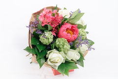 Bouquet of peonies, roses and alstroemeria. On white background Stock Image