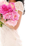 Bouquet of peonies in woman's hands Royalty Free Stock Photography