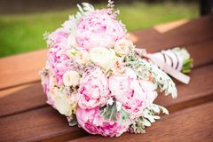 Bouquet of peonies on a wooden background royalty free stock photo