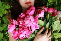 Bouquet of Peony. beautiful young woman lies among peonies. Holidays and Events. Valentine`s Day. Spring blossom royalty free stock images