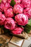 Bouquet of peony roses with letter and note saying - I love you. Bouquet of peony roses with letter and note saying - I love you stock photos