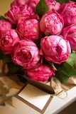 Bouquet of peony roses with letter with space for text.  royalty free stock photography